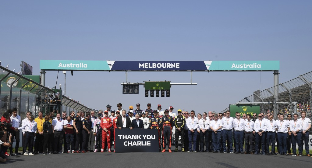 The drivers pose with members of the FIA for a group photo and tribute to Charlie Whiting, the former FIA Formula One Race Director, ahead of the Aust