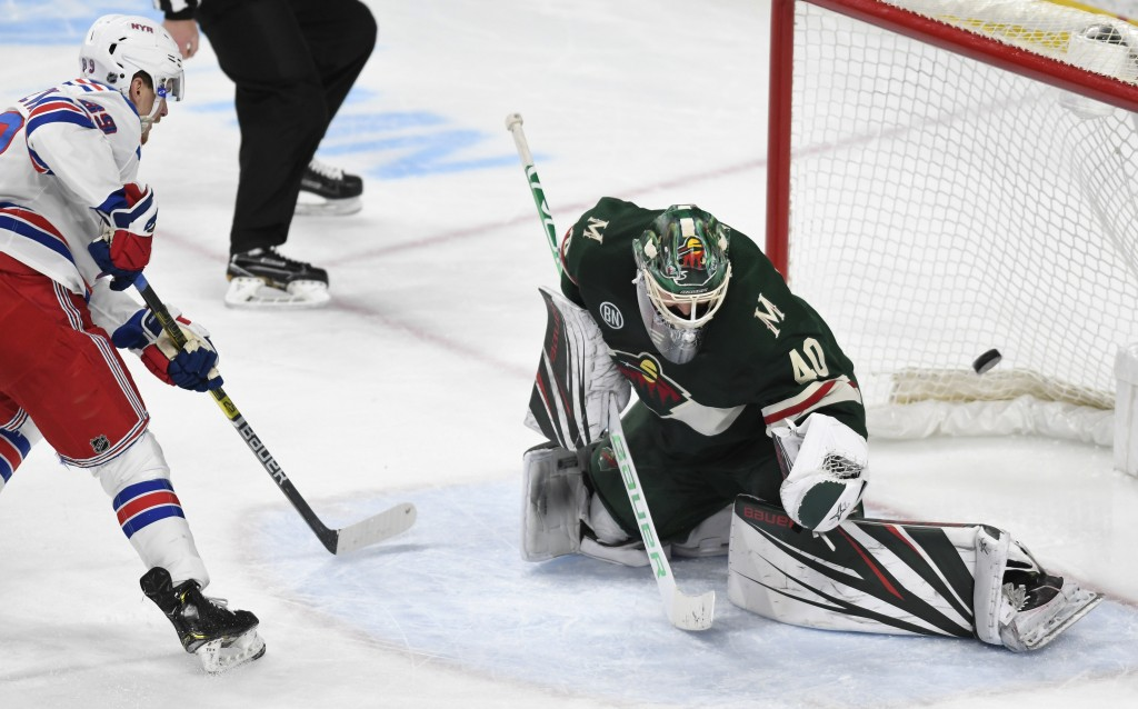 New York Rangers' Pavel Buchnevich, left, of Russia, puts the puck past Minnesota Wild goalie Devan Dubnyk (40) for a goal in the third period of an N