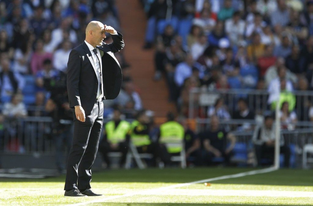 Real Madrid's coach Zinedine Zidane stands during a Spanish La Liga soccer match between Real Madrid and Celta at the Santiago Bernabeu stadium in Mad