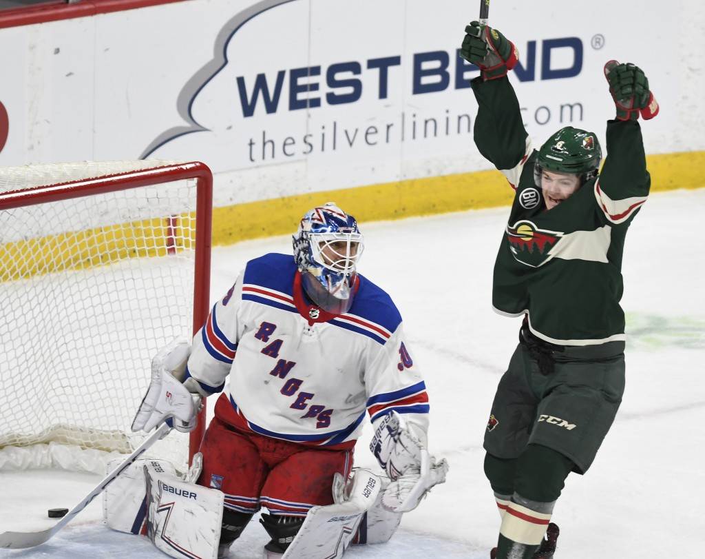 Minnesota Wild's Ryan Donato, right, celebrates his second goal in front of New York Rangers goalie Henrik Lundqvist, of Sweden, in the first period o