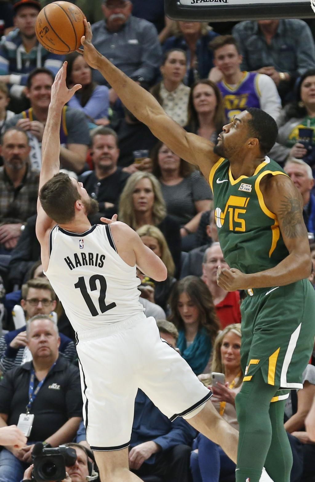 Utah Jazz forward Derrick Favors (15) blocks the the shot of Brooklyn Nets forward Joe Harris (12) during the first half of an NBA basketball game Sat