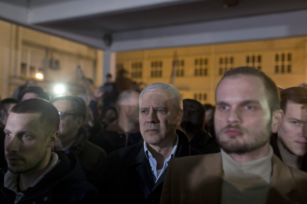 Boris Tadic, center, former Serbian president, stands with other demonstrators at the state-run TV headquarters in Belgrade, Serbia, Saturday, March 1