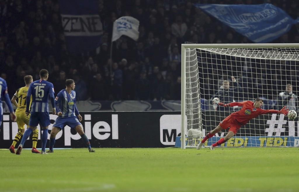 Dortmund's Marco Reus, left, scores his side's 3rd goal during the German Bundesliga soccer match between Hertha BSC Berlin and Borussia Dortmund in B