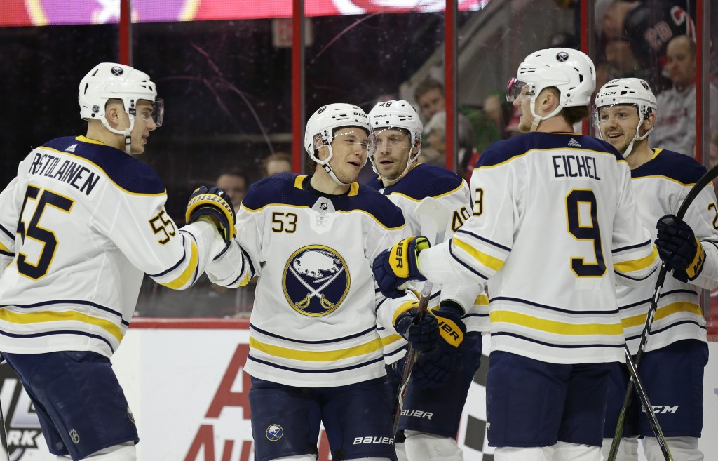 Buffalo Sabres' Jeff Skinner (53) is congratulated by Rasmus Ristolainen (55) and Jack Eichel (9) following Skinner's goal against the Carolina Hurric