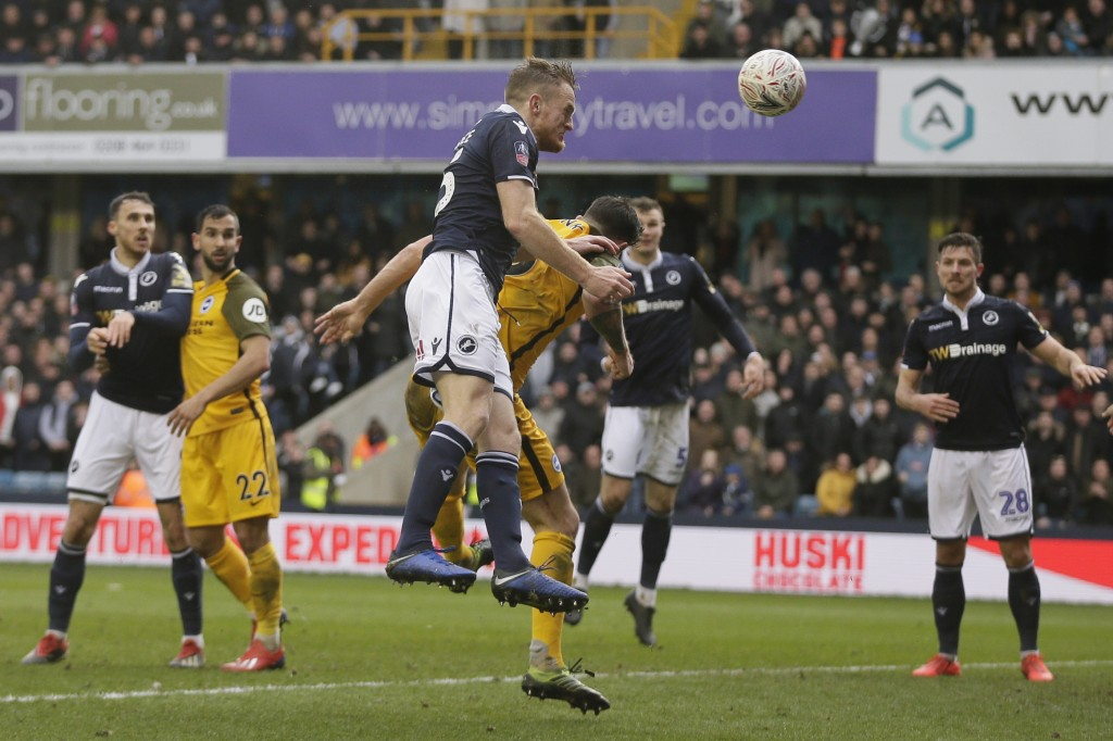 Millwall's Alex Pearce scores a goal during the English FA Cup quarterfinal soccer match between Millwall and Brighton & Hove Albion at The Den in Lon