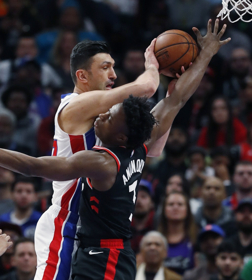 Detroit Pistons center Zaza Pachulia (27) passes the ball as Toronto Raptors forward OG Anunoby (3) defends during the first half of an NBA basketball