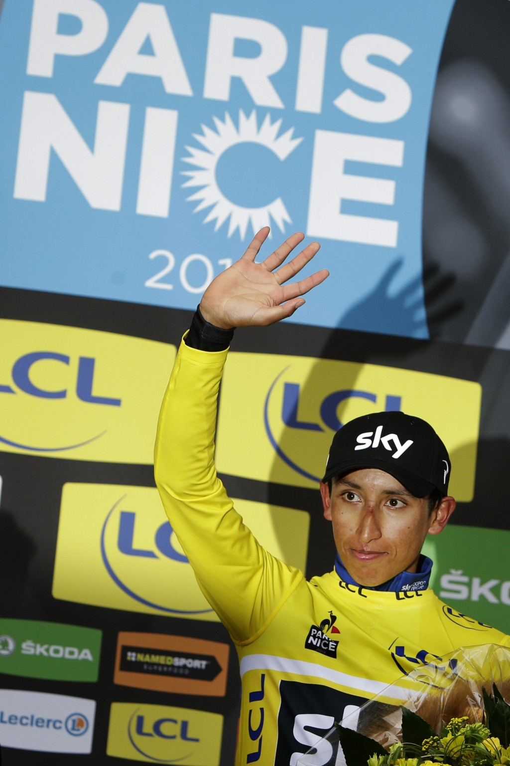 Colombia's Egan Arley Bernal Gomez, wearing the overall leader's yellow jersey, celebrates on the podium after the eighth and final stage of the Paris
