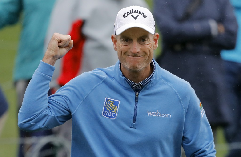 Jim Furyk pumps his fist after making a birdie on the ffifth hole during the final round of The Players Championship golf tournament Sunday, March 17,...