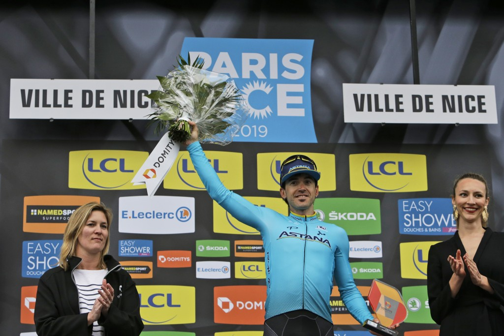 Stage winner Spain's Ion Izaguirre Insausti celebrates on the podium after the eighth stage of the Paris Nice cycling race with start and finish in Ni