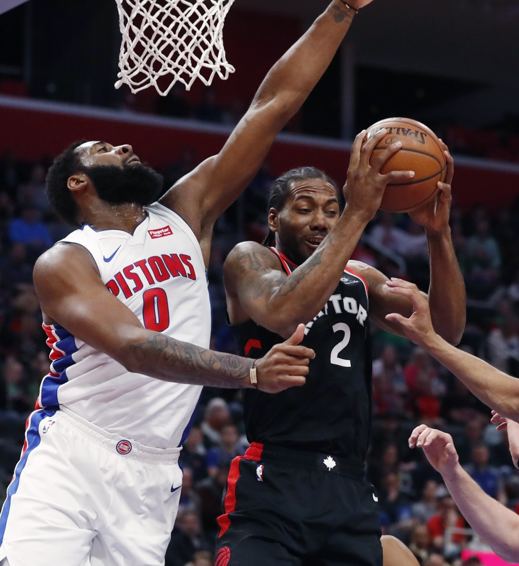 Toronto Raptors forward Kawhi Leonard (2) pulls down a rebound as Detroit Pistons center Andre Drummond (0) defends during the first half of an NBA ba