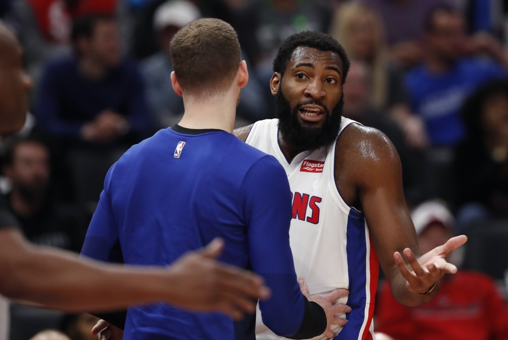 Detroit Pistons center Andre Drummond, right, looks toward referee Tony Brown after a call during the first half of an NBA basketball game against the
