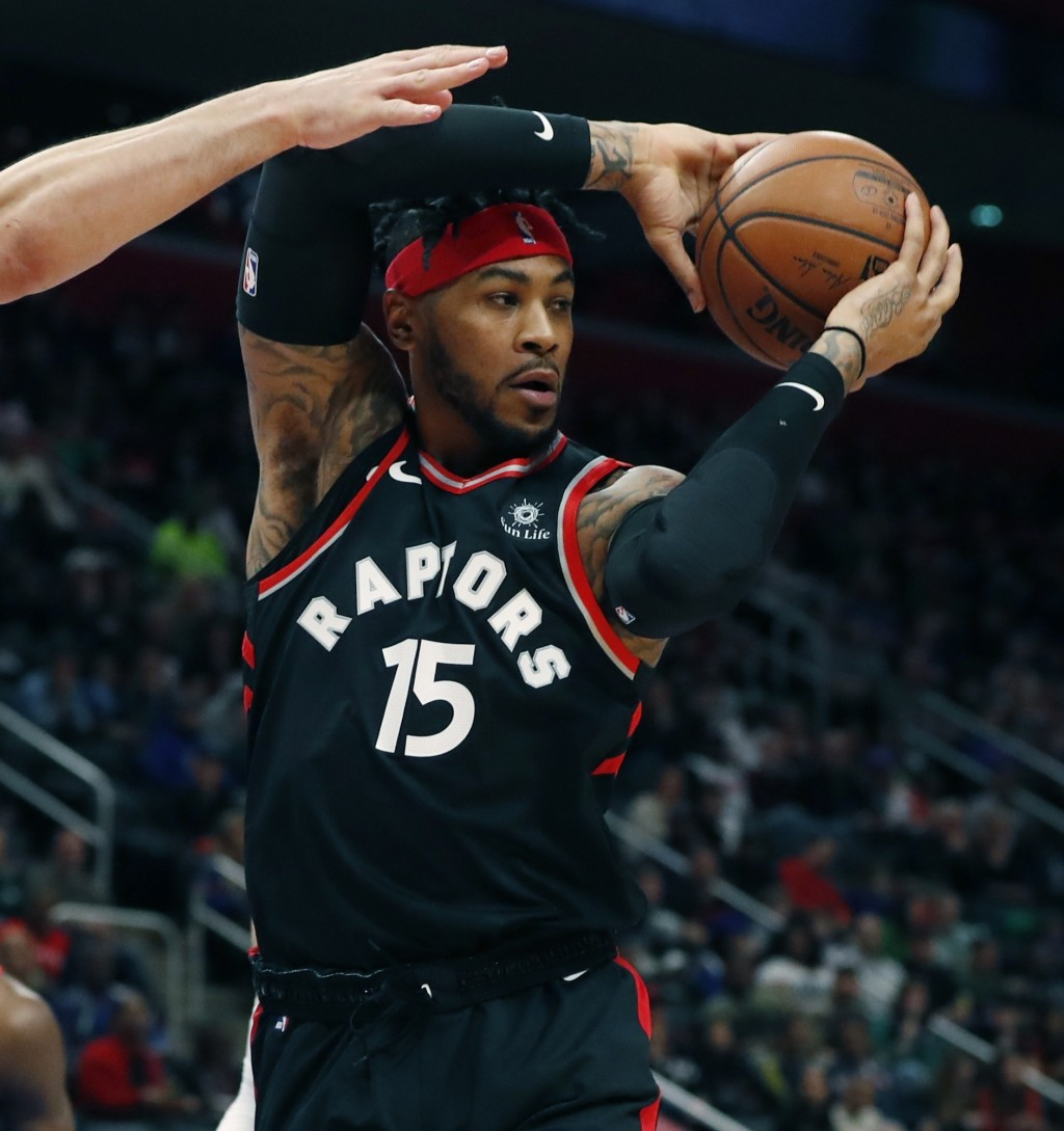 Toronto Raptors forward Eric Moreland looks to pass during the first half of an NBA basketball game against the Detroit Pistons, Sunday, March 17, 201...