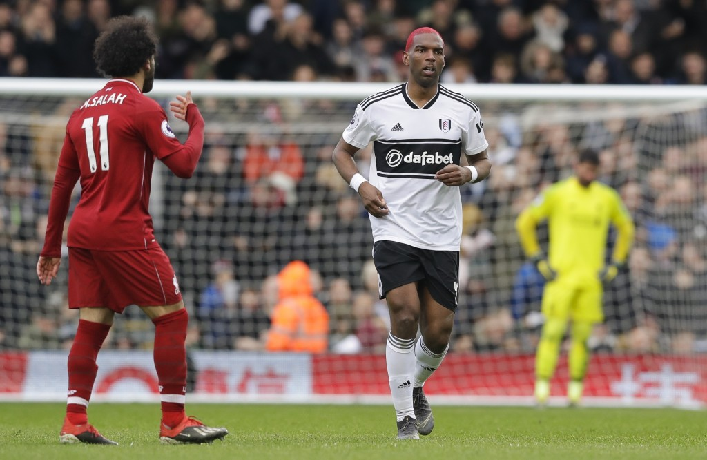 Fulham's Ryan Babel, right, runs next to Liverpool's Mohamed Salah after scoring his side's opening goal during the English Premier League soccer matc