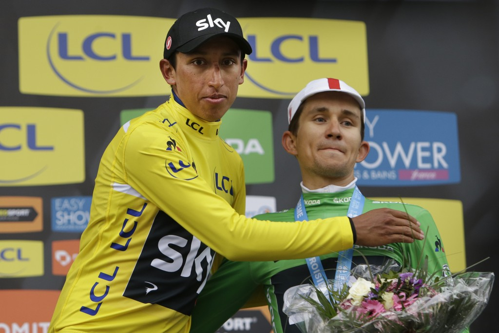 Colombia's Egan Arley Bernal Gomez, wearing the overall leader's yellow jersey, hugs third place teammate Poland's Michal Kwiatkowski, wearing the bes