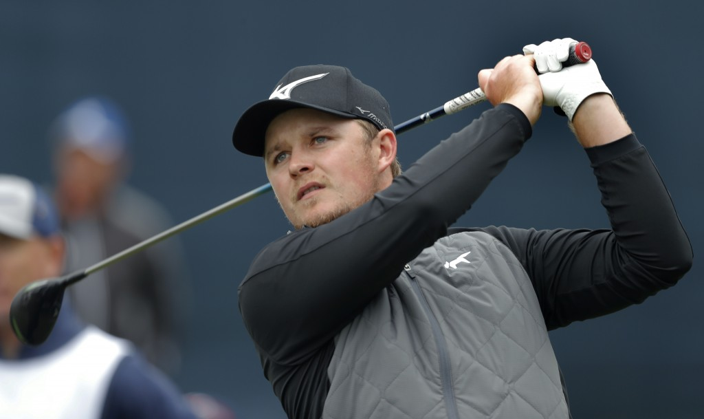 Eddie Pepperell, of England, hits his tee shot on the 18th hole during the final round of The Players Championship golf tournament Sunday, March 17, 2...