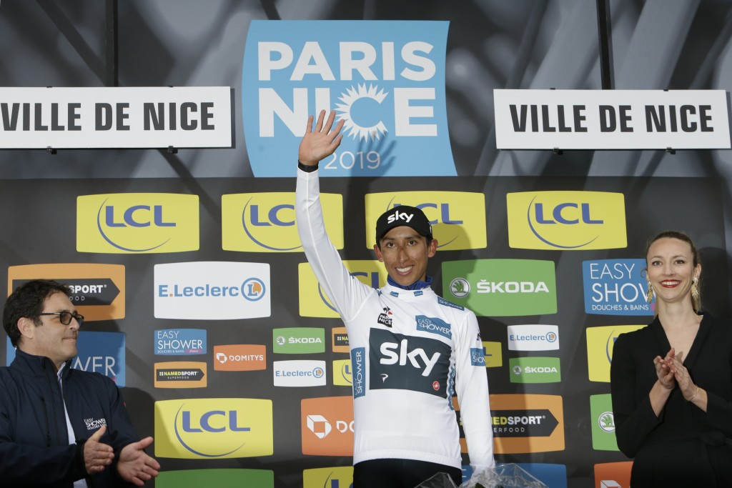 Winner of the Paris Nice cycling race Colombia's Egan Arley Bernal Gomez, who also took the best young rider's white jersey, celebrates on the podium