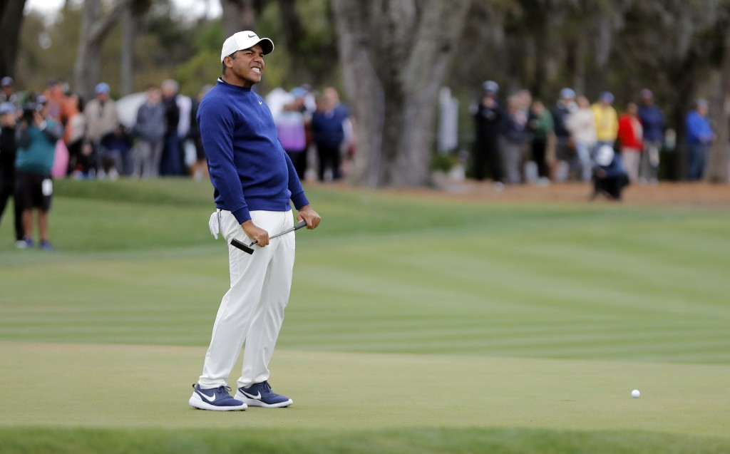 Jhonattan Vegas, of Venezuela, reacts to a missed birdie putt on the 18th hole during the final round of The Players Championship golf tournament Sund...