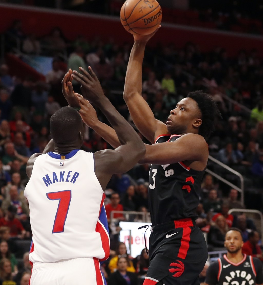 Toronto Raptors forward OG Anunoby (3) shoots over the defense of Detroit Pistons forward Thon Maker (7) during the first half of an NBA basketball ga...