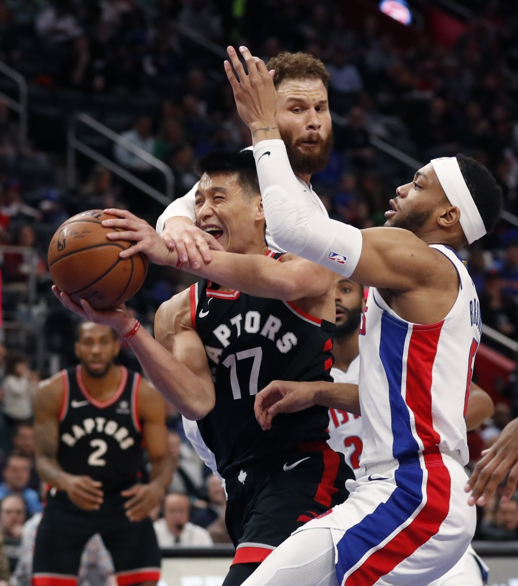 Toronto Raptors guard Jeremy Lin (17) is fouled by Detroit Pistons forward Blake Griffin as guard Bruce Brown, right, defends during the first half of...