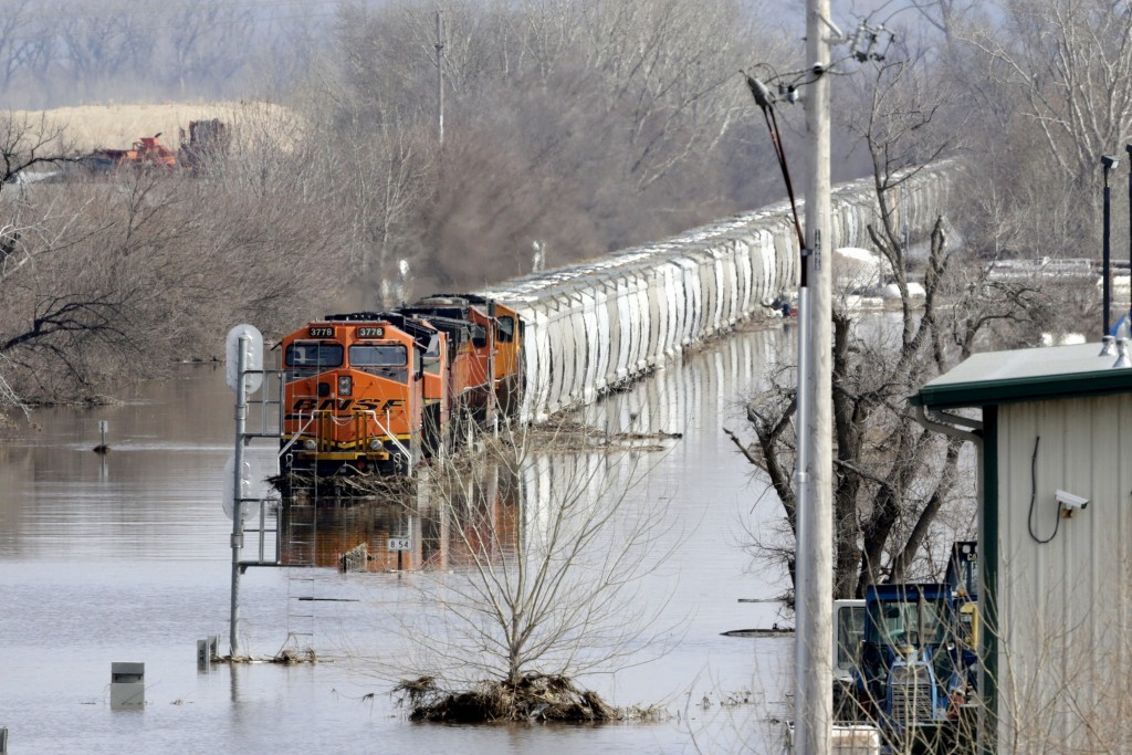 A BNSF train sits in flood waters from the Platte River, in Plattsmouth, Neb., Sunday, March 17, 2019. Hundreds of people remained out of their homes ...