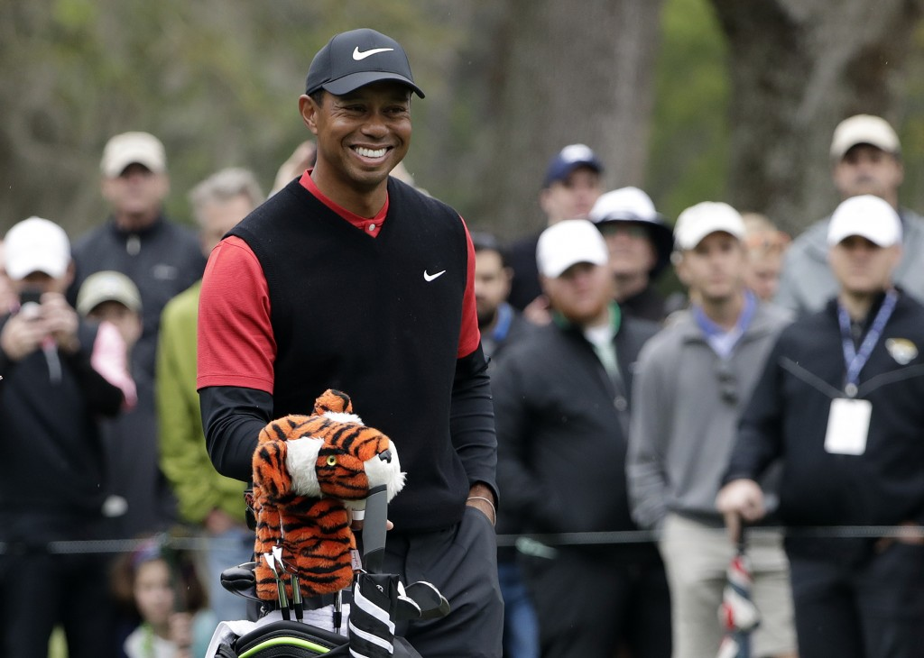 Tiger Woods laughs as he waits to tee off on the eighth hole during the final round of The Players Championship golf tournament Sunday, March 17, 2019...