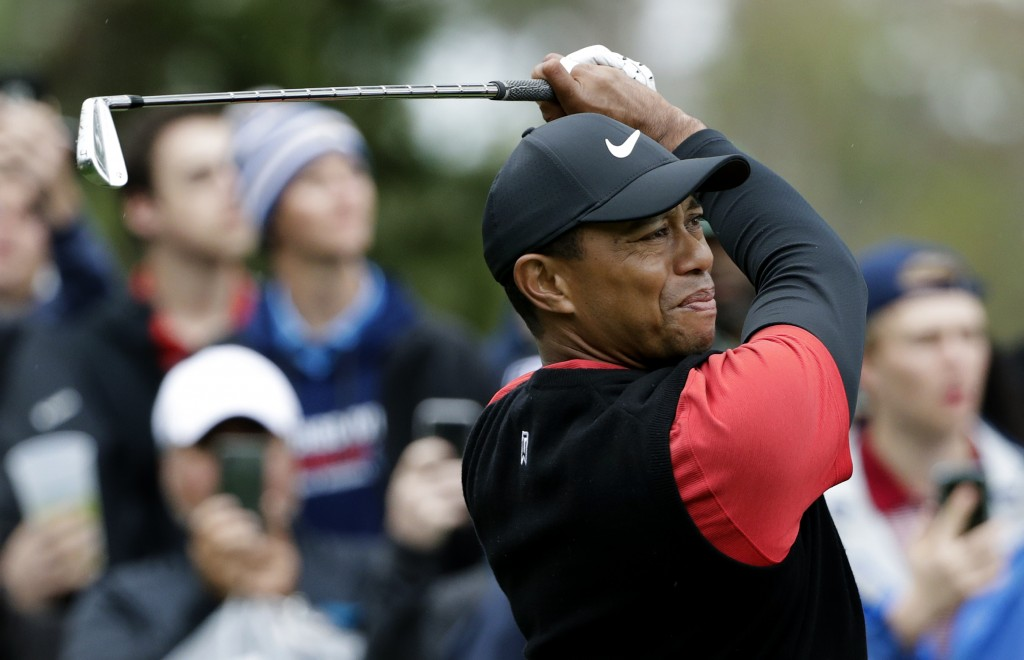 Tiger Woods tees off on the eighth hole during the final round of The Players Championship golf tournament Sunday, March 17, 2019, in Ponte Vedra Beac...