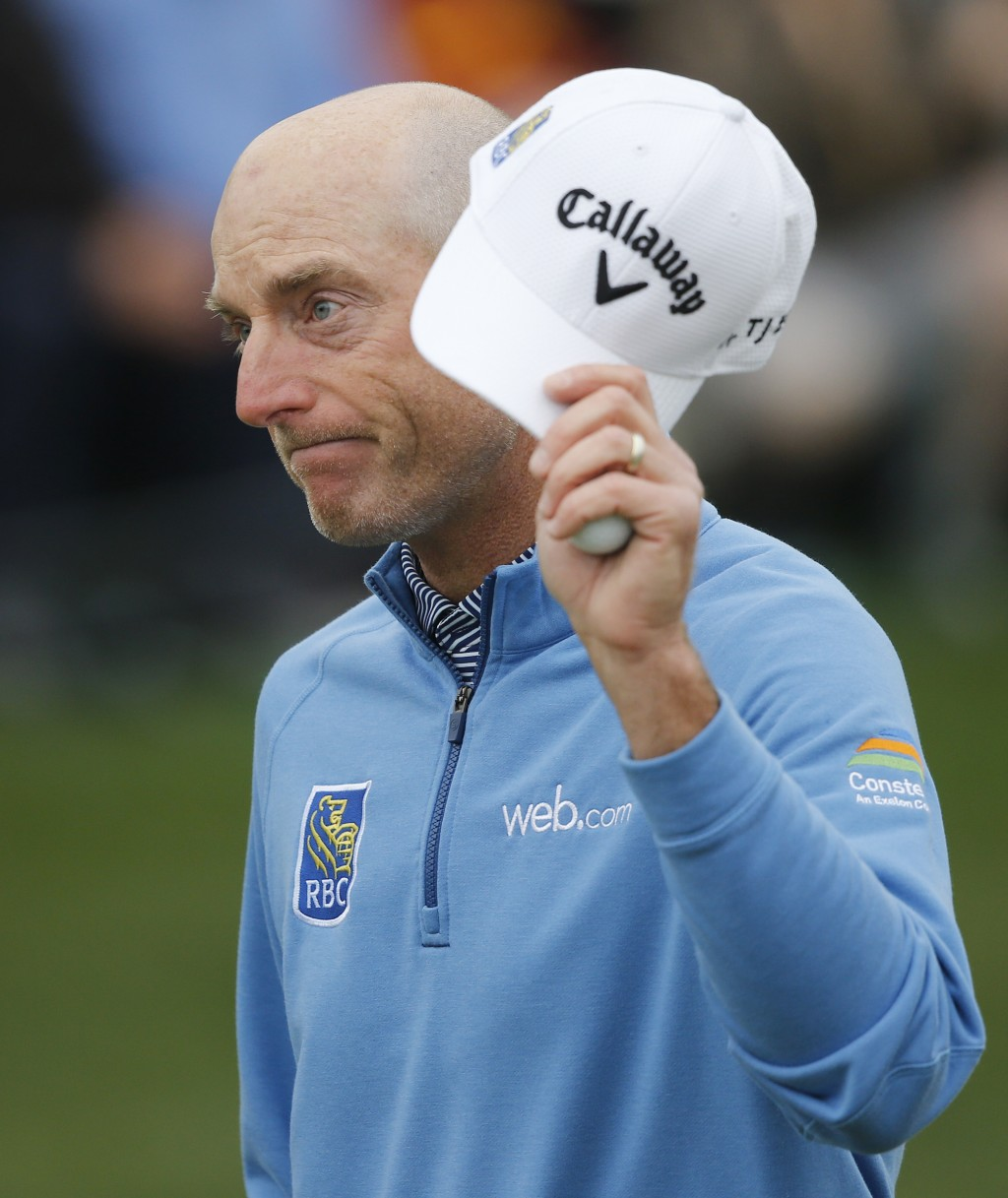Jim Furyk tips his cap to the gallery after finishing his round during The Players Championship golf tournament Sunday, March 17, 2019, in Ponte Vedra...