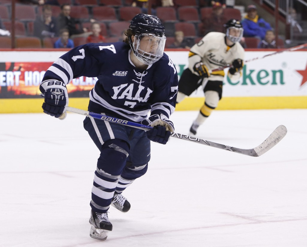 FILE - In this Jan. 10, 2016, file photo, Yale forward Joe Snively (7) skates during the first period of an NCAA college game against Michigan Tech at