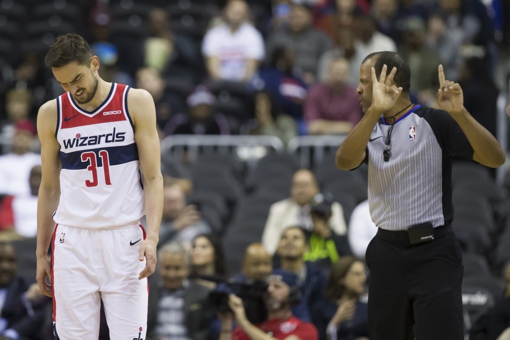 Washington Wizards guard Tomas Satoransky (31), from the Czech Republic, reacts to a foul call from referee Eric Lewis (42) during the first half of a...