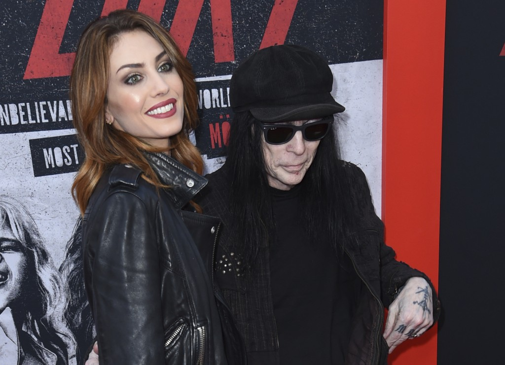 """Fai McNasty, left, and Mick Mars arrive at the world premiere of """"The Dirt"""" on Monday, March 18, 2019, at ArcLight Hollywood in Los Angeles. (Photo by..."""