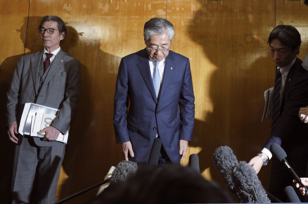 In this Tuesday, March 19, 2019, file photo, International Olympics Committee member and head of the Japanese Olympic Committee Tsunekazu Takeda bows ...