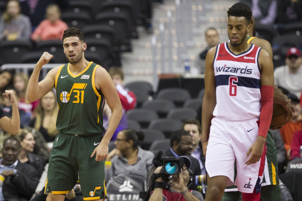 Utah Jazz forward Georges Niang (31) celebrates his basket near Washington Wizards forward Troy Brown Jr. (6) during the first half of an NBA basketba...