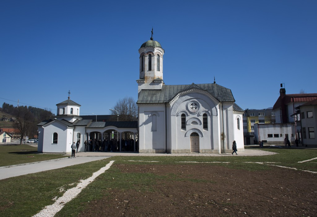 In this Sunday, March 17, 2019 photo, a church service is held at an Orthodox church in the Bosnian Serb wartime stronghold of Pale, Bosnia-Herzegovin...