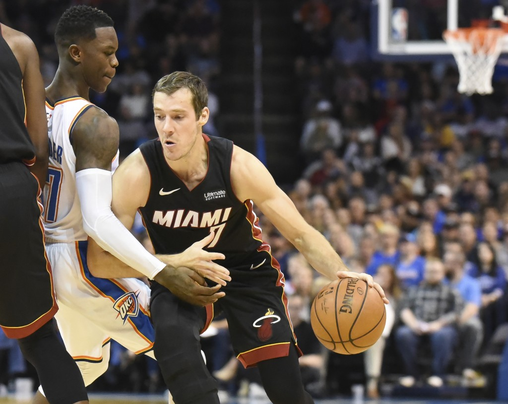 Miami Heat guard Goran Dragic, right, drives past Oklahoma City Thunder guard Dennis Schroder, left, in the first half of an NBA basketball game again...