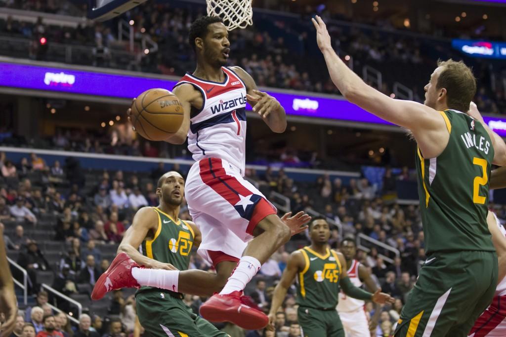 Washington Wizards forward Trevor Ariza (1) passes the ball around Utah Jazz forward Joe Ingles (2), from Australia, during the first half of an NBA b