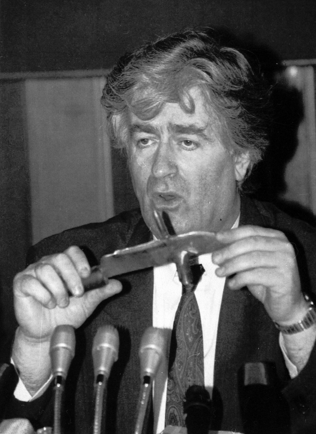 FILE - In this Sept. 23, 1992 file photo, Bosnian Serb leader Radovan Karadzic holds a knife he said was seized from Bosnian Croat soldiers in Bosnia