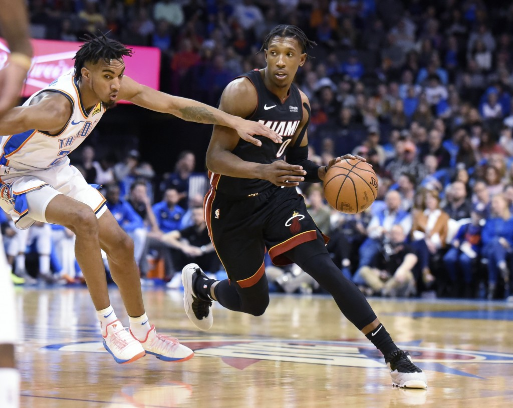 Miami Heat Josh Richardson, right, drives past Oklahoma City guard Terrance Robinson, right, in the first half of an NBA basketball game , Monday, Mar...