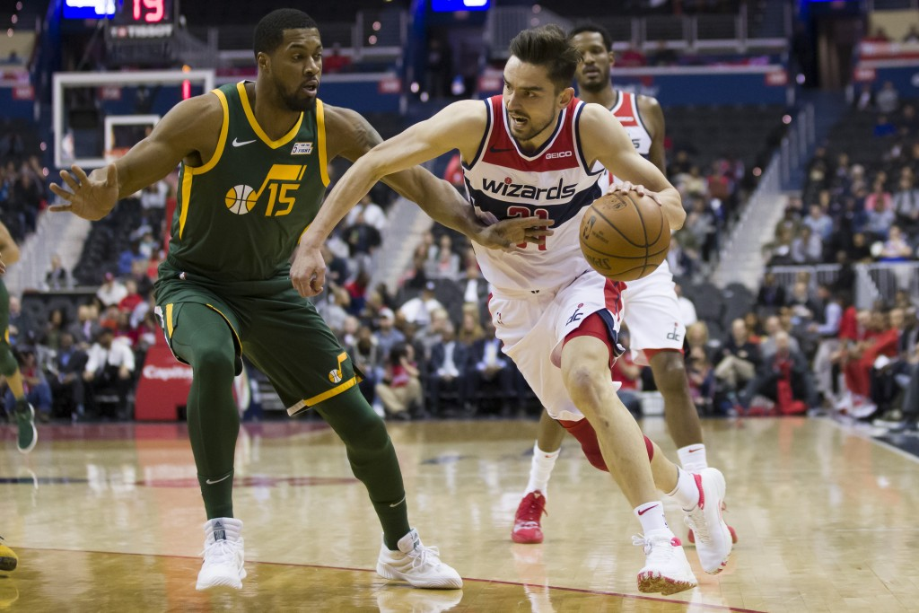 Washington Wizards guard Tomas Satoransky (31), from the Czech Republic, works to get past Utah Jazz forward Derrick Favors (15) during the first half...