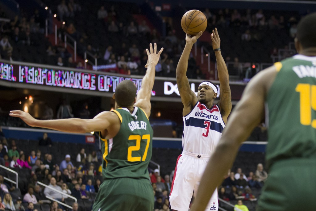 Washington Wizards guard Bradley Beal (3) shoots over Utah Jazz center Rudy Gobert (27), from France, during the first half of an NBA basketball game ...