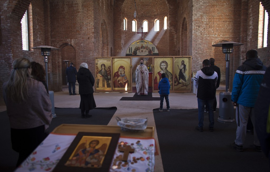 In this Sunday, March 17, 2019 photo, a church service is held at an Orthodox church in the Bosnian Serb wartime stronghold of Pale, Bosnia-Herzegovin