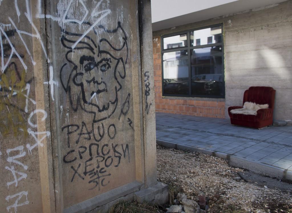 In this Sunday, March 17, 2019 photo, graffiti depicting Bosnian Serb wartime leader Radovan Karadzic on a wall in the Bosnian Serb wartime stronghold...