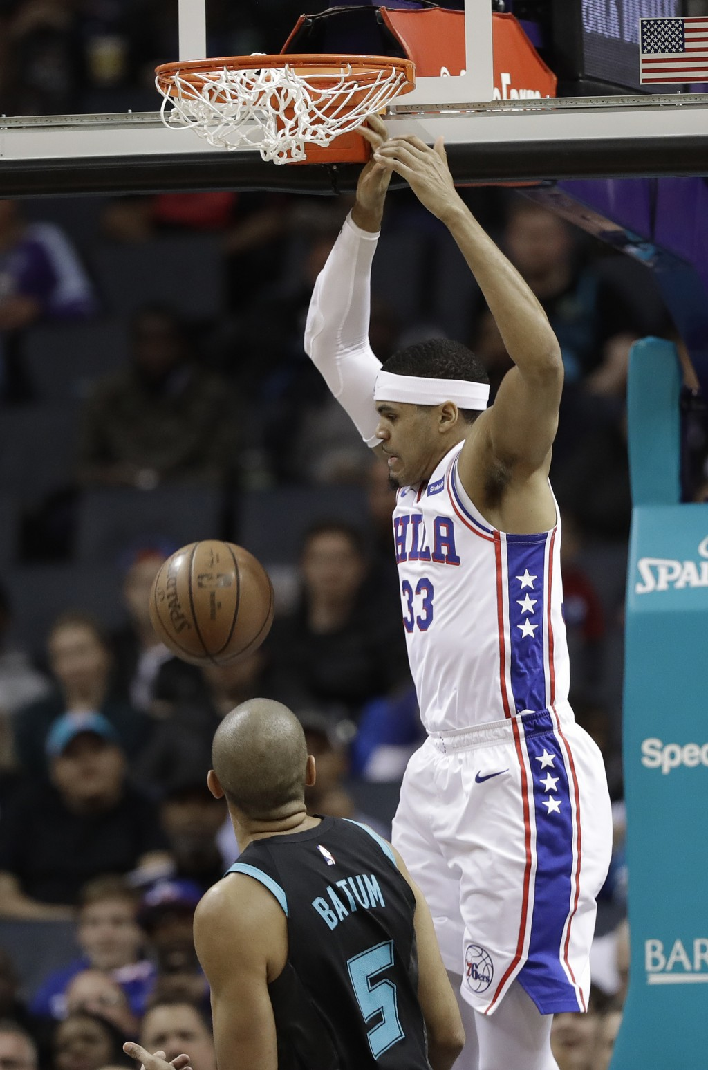 Philadelphia 76ers' Tobias Harris (33) dunks against Charlotte Hornets' Nicolas Batum (5) during the first half of an NBA basketball game in Charlotte
