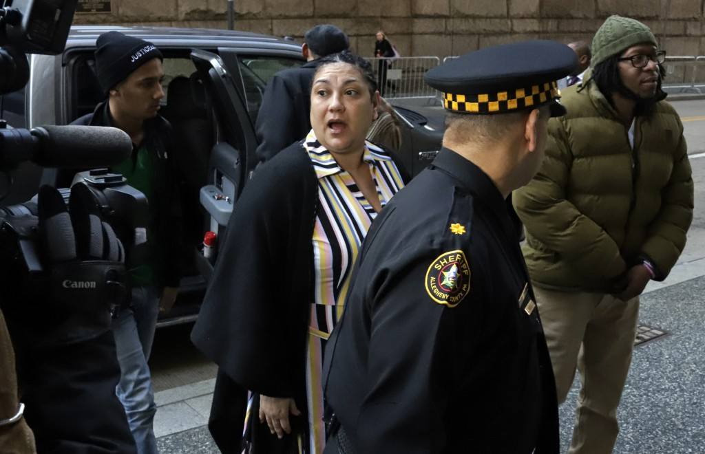 Michelle Kenney, center, the mother of Antwon Rose II, arrives at the Allegheny County Courthouse with supporters on the second day of the trial for M...