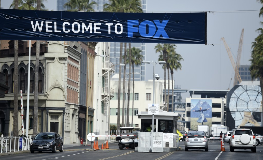 Cars enter and leave Fox Studios, Tuesday, March 19, 2019, in Los Angeles. Disney has closed its $71 acquisition of Fox's entertainment business on We...