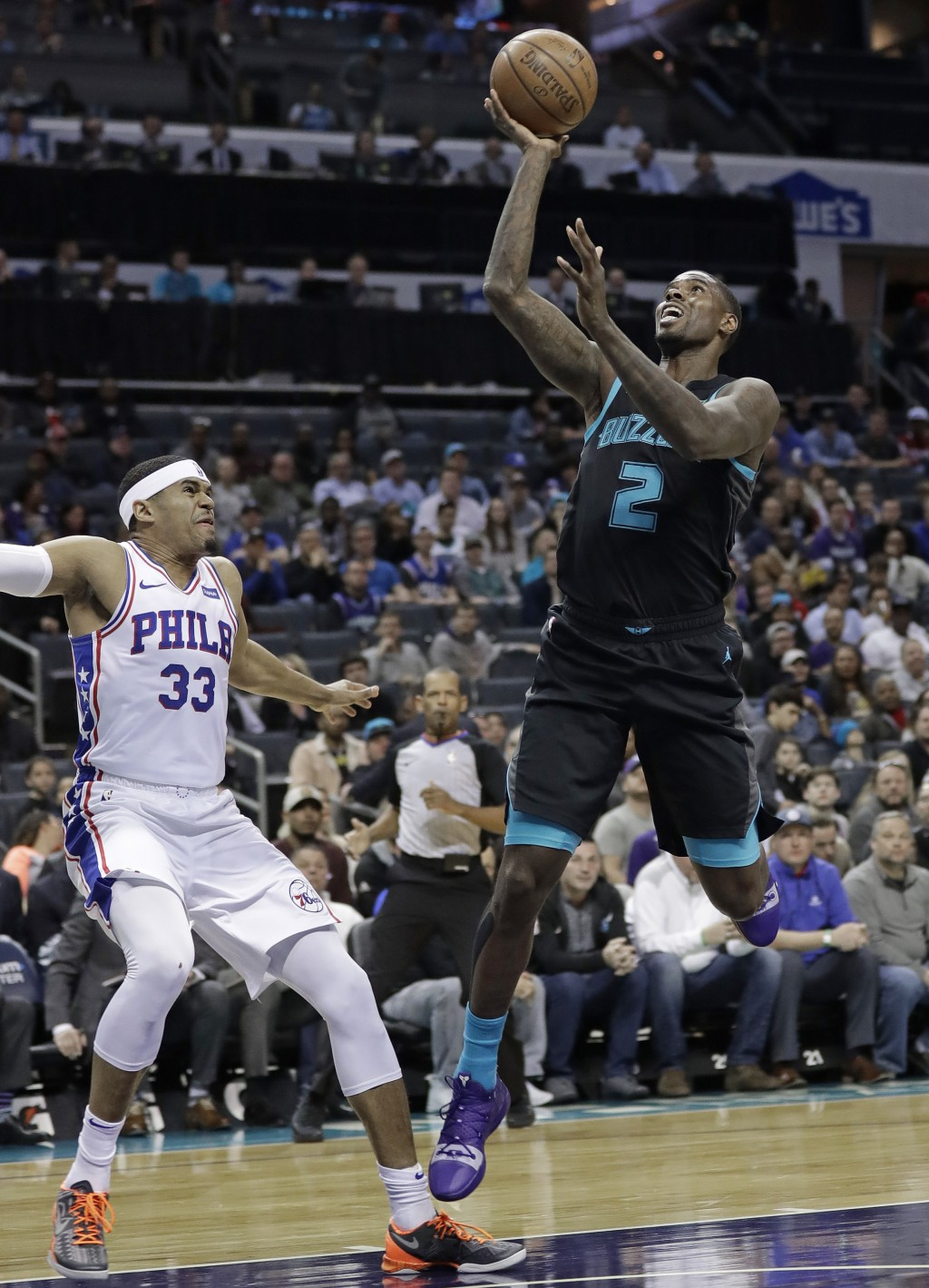 Charlotte Hornets' Marvin Williams (2) shoots against Philadelphia 76ers' Tobias Harris (33) during the first half of an NBA basketball game in Charlo