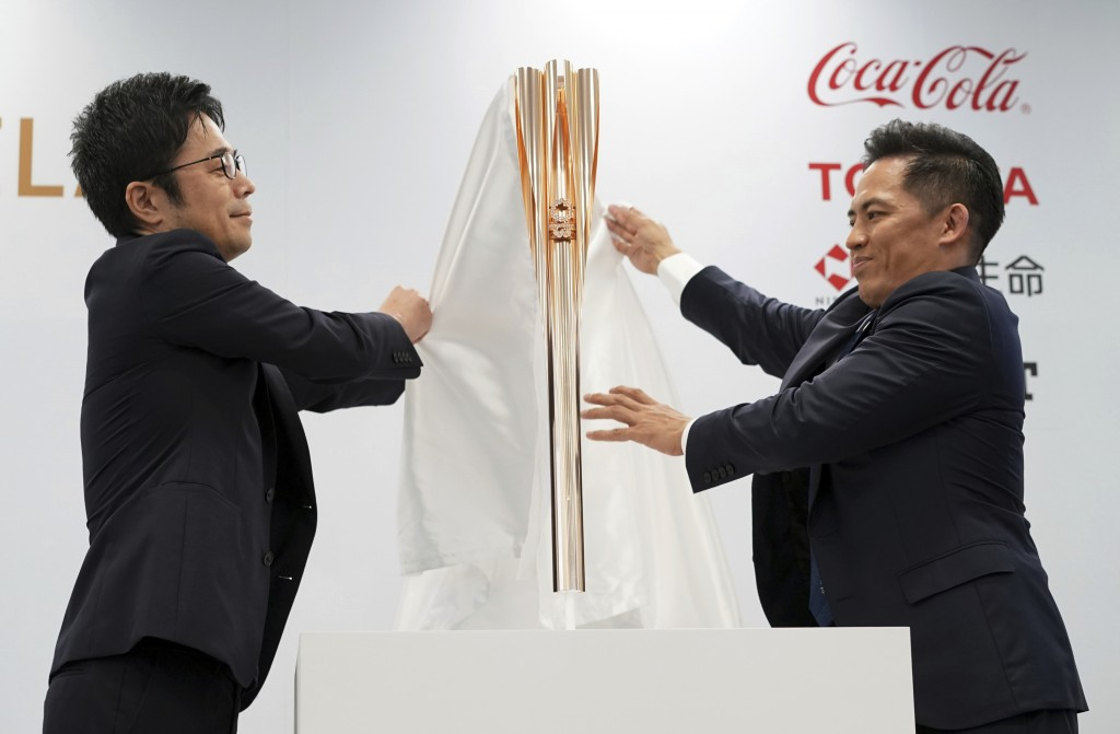 In this Wednesday, March 20, 2019, file photo, the Olympic torch of the Tokyo 2020 Olympic Games is unveiled during a press conference in Tokyo. The t...