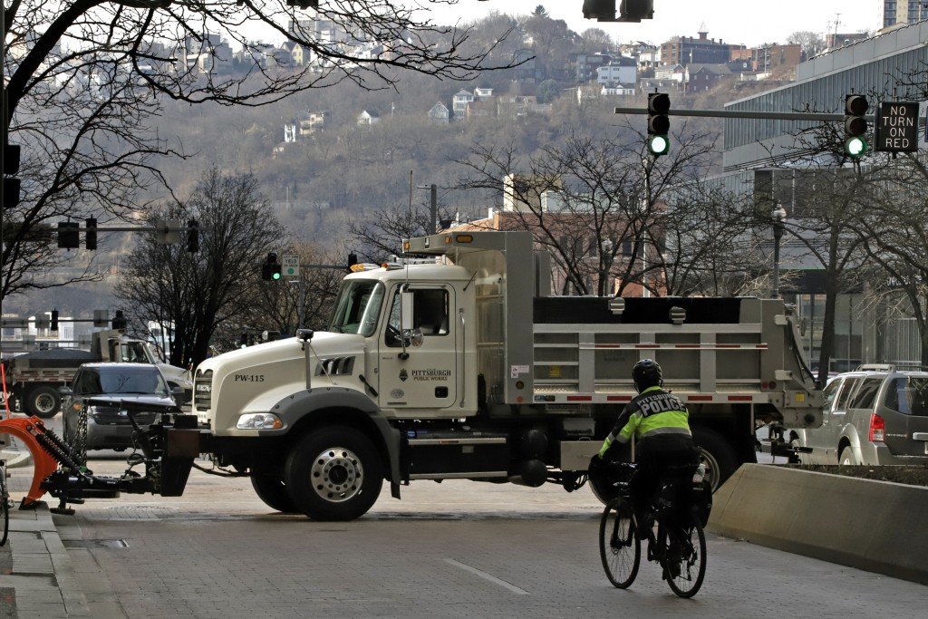 A Pittsburgh public works trucks block traffic on Grant St. in front of the Allegheny County Courthouse on the second day of the trial for Michael Ros...