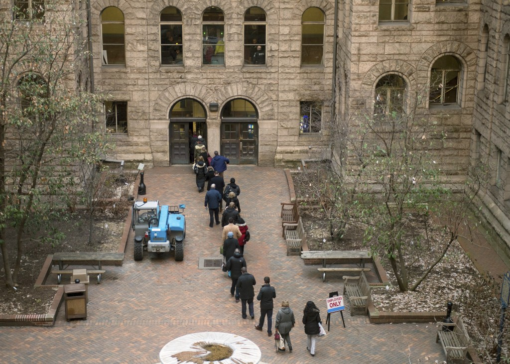 People arrive to the Allegheny County Courthouse prior to the start of the second day of the homicide trial of former East Pittsburgh police officer M...