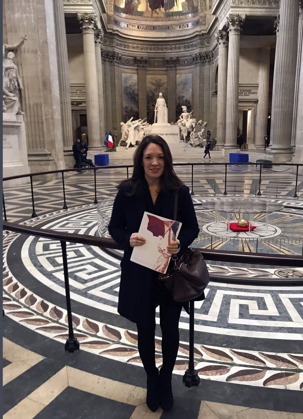 Britain's Catherine Norris Trent holds her document after a naturalization ceremony in Paris' Pantheon monument, Thursday, March 21, 2019. With the lo