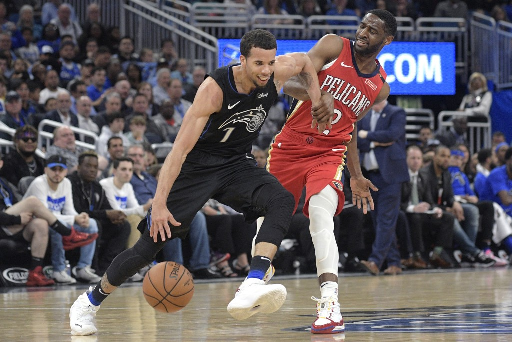 Orlando Magic guard Michael Carter-Williams (7) is fouled by New Orleans Pelicans guard Ian Clark (2) while pushing the ball up the court during the s...
